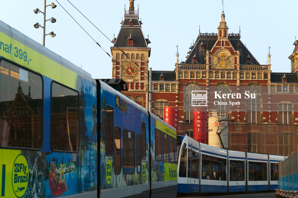 Bus passes by Central station, Amsterdam, Netherlands