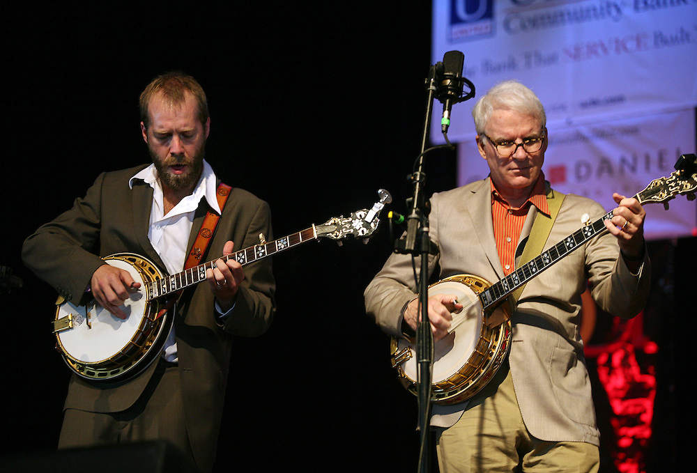 BREVARD, NC - SEPTEMBER 12 :  (L) Graham Sharp and Steve Martin on stage as the Steep Canyon Rangers perform in the Mountain Song Festival at The Brevard Music Center on September 12, 2009, in Brevard, North Carolina, USA. (Photo by Logan Mock-Bunting/Getty Images)