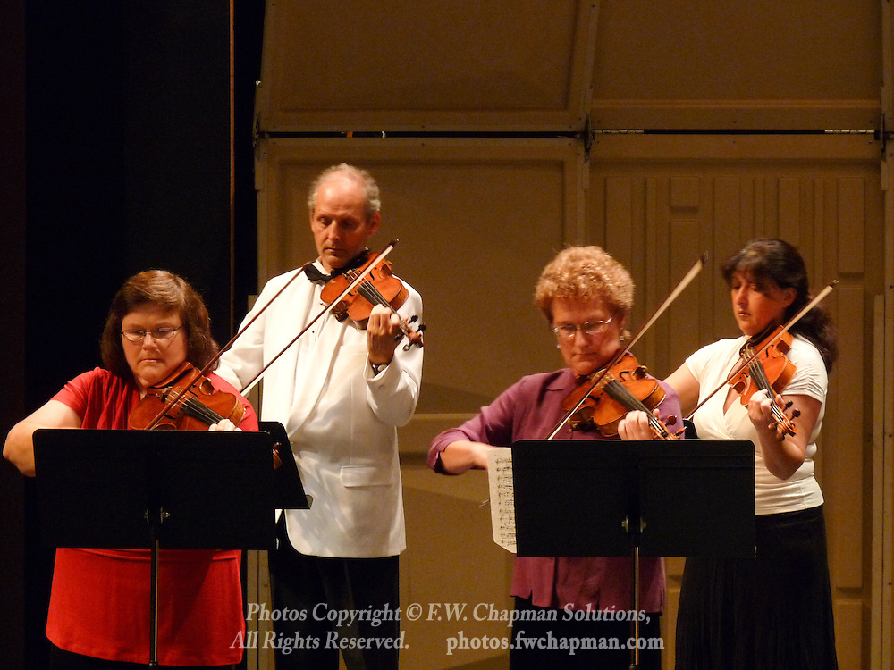 Valley Vivaldi violinists Mary Ogletree, Simon Maurer, Rebecca Brown, and Inna Eyzerovich perform in a Sunday evening concert starting at 7:30 PM on June 28, 2009 at Cedar Crest College in Allentown, Pennsylvania, USA..