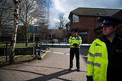 © Licensed to London News Pictures. 06/03/2018. Salisbury, UK. Police officers stands on a cordon at the scene near the Maltings shopping centre in Salisbury where former Russian spy Sergei Skripal and a woman in her 30s were taken ill with suspected poisoning. The couple where found unconscious on bench in Salisbury shopping centre. Specialist units have been called in to deal with any possible contamination. Photo credit: Ben Cawthra/LNP