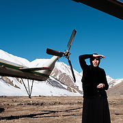 'Morchili' Mariami, an Orthodox Christian nun who lives in a nunnery in the remote village of Abano in the Truso Valley, near the occupied territory of South Ossetia in the Mtskheta-Mtianeti region of Georgia, beside a Border Police helicopter that made a detour to deliver building supplies to her.