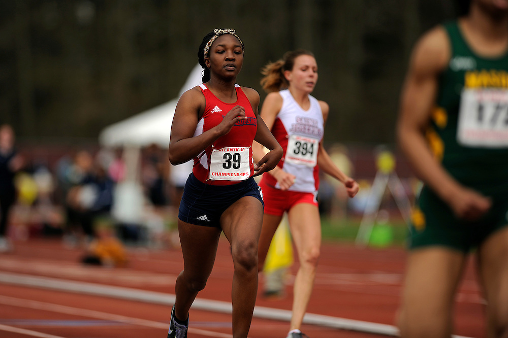AMHERST, MA - MAY 3: From left, Elisa Joyce of Duquesne University and Carly McGowan of St. Joseph's University, background, race during the women's 100-meter dash preliminary rounds during Day 1 of the Atlantic 10 Outdoor Track and Field Championships at the University of Massachusetts Amherst Track and Field Complex on May 3, 2014 in Amherst, Massachusetts. (Photo by Daniel Petty/Atlantic 10)