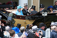 Queen Elizabeth ll and Prince Philip, Duke of Edinburgh arrive in an open carriage on Last Day at Royal Ascot on June 18, 2011 in Ascot, England. (Photo by Shoja Lak)