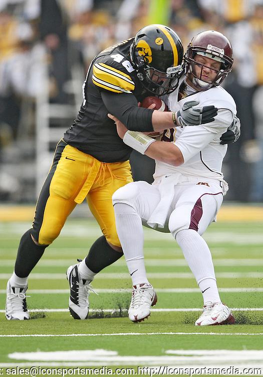 November 21, 2009: Minnesota quarterback Adam Weber (8) is hit by Iowa defensive tackle Christian Ballard (46) during the first half of the Iowa Hawkeyes 12-0 win over the Minnesota Golden Gophers at Kinnick Stadium in Iowa City, Iowa on November 21, 2009.