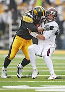 November 21, 2009: Minnesota quarterback Adam Weber (8) is hit by Iowa defensive tackle Christian Ballard (46) during the first half of the Iowa Hawkeyes 12-0 win over the Minnesota Golden Gophers at Kinnick Stadium in Iowa City, Iowa on November 21, 2009.
