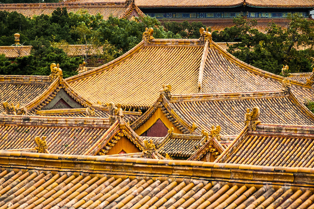 Stock photograph of yellow tiled rooves in the Forbidden City in Beijing