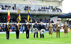 Bristol Rovers Manager, Darrell Clarke and chairman Nick Higgs (centre) with flag bearers and Armed Forces personnel for Remembrance Day - Photo mandatory by-line: Neil Brookman/JMP - Mobile: 07966 386802 - 15/11/2014 - SPORT - Football - Bristol - Memorial Stadium - Bristol Rovers v Kidderminster - Vanarama Football Conference