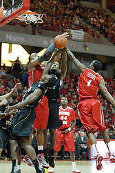 17 February 2013:  Cleanthony Early, Jackie Carmichael, Carl Hall and Tyler Brown all reach for the same rebound during an NCAA Missouri Valley Conference mens basketball game where the Shockers of Wichita State played the Illinois State Redbirds  in Redbird Arena, Normal IL