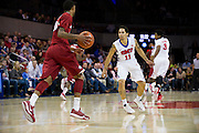 DALLAS, TX - NOVEMBER 25: Nic Moore #11 of the SMU Mustangs defends against the Arkansas Razorbacks on November 25, 2014 at Moody Coliseum in Dallas, Texas.  (Photo by Cooper Neill/Getty Images) *** Local Caption *** Nic Moore