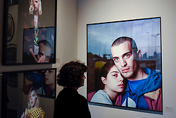 "London, UK.  17 May 2017.  A visitor views ""Untitled (The Couple of the Year"", 2016, by Jesús Madriñán.  Preview of Photo London 2017 at Somerset House.  Held for the third time, the event showcases the best in contemporary photography, from 89 galleries from 16 different countries, for collectors and enthusiasts and will be on from 18 - 21 May. Credit: Stephen Chung / Alamy Live News"