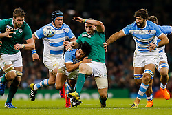 Ireland Inside Centre Robbie Henshaw is tackled by Argentina Outside Centre Matias Moroni - Mandatory byline: Rogan Thomson/JMP - 07966 386802 - 18/10/2015 - RUGBY UNION - Millennium Stadium - Cardiff, Wales - Ireland v Argentina - Rugby World Cup 2015 Quarter Finals.