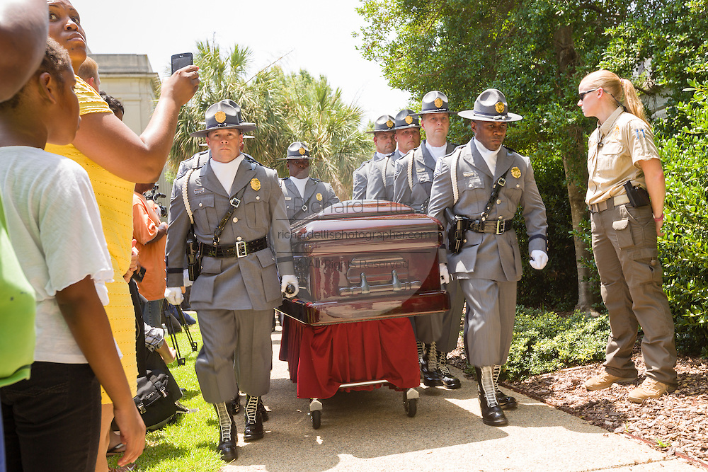 Police honor guard escort the casket of slain State Senator Clementa Pinckney from the horse-drawn caisson after arriving at the State House June 24, 2015 in Columbia, South Carolina. Pinckney is one of the nine people killed in last weeks Charleston church massacre.