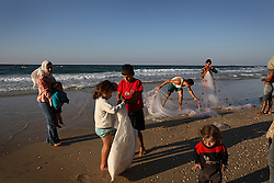 Families of fisherman are the only people to be seen on the beach in Gaza Strip. Beit Hanoun, Palestinian Territories, Nov. 17, 2006.  The beaches here are deserted after Israeli artillery fire allegedly killed a family, a charge Israel denies.  According to Human Rights Watch, since September 2005, Israel has fired about 15,000 rounds at Gaza while Palestinian militants have fired around 1,700 back.