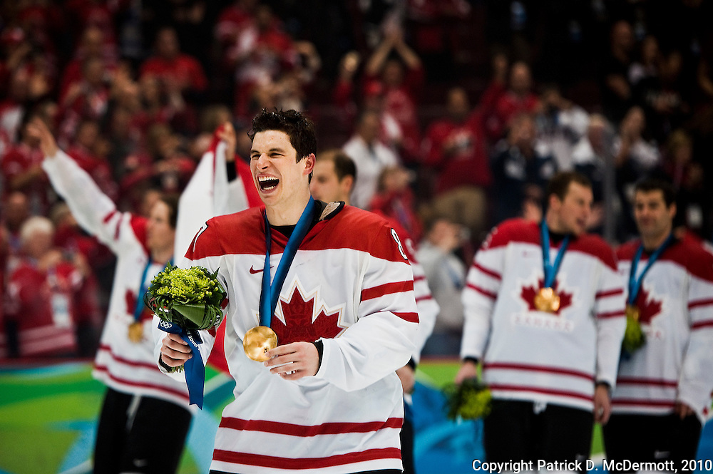 Sidney Crosby #87, CAN, celebrates after receiving his gold medal after Canada defeated the USA 3-2 in overtime on the final day of the 2010 Vancouver Winter Olympics at the Canada Hockey Place in Vancouver, British Columbia, Sunday, Feb. 28, 2010. Crosby scored the game winning goal.