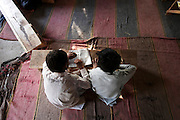Young children study from the Koran in aq small Muslim madrasa in rural Sindh Province.