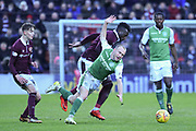 Isma Goncalves forces 10 Dylan McGeouch off the ball during the William Hill Scottish Cup 4th round match between Heart of Midlothian and Hibernian at Tynecastle Stadium, Gorgie, Scotland on 21 January 2018. Photo by Kevin Murray.