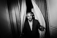 """Palermo, Italy - 20 July, 2012: President of the Sicilian Region Raffaele Lombardo, 61, walks out of his office after an interview at Palazzo d'Orleans, headquarters of the Presidency of the Sicilian Regional Assembly on 20 July, 2012, in Palermo, Italy.<br /> <br /> Mario Monti has expressed """"serious concerns"""" that Sicily's regional government is heading towards default and has asked its governor – who is under investigation for suspected links to the Mafia – to confirm his intention to resign. Sicily was among 23 Italian """"sub-sovereign entities"""" downgraded by Moody's rating agency on Monday, a development that has raised the possibility of a chain of defaults at the local level unless the central government intervenes. Sicily's debt was €5.3bn at the end of 2011, according to Bloomberg. Mr Monti, Italy's technocratic prime minister, indicated in his statement on Tuesday that Rome would take action to bail out Sicily's debts. Sicily has long been identified as one of the most poorly managed of Italy's regions, with the public sector accounting for the bulk of the island's economy and jobs. Commentators call it """"Italy's Greece""""."""