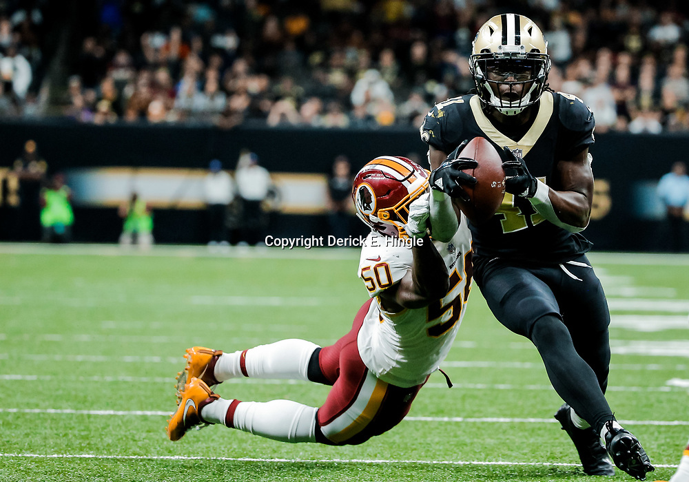 Nov 19, 2017; New Orleans, LA, USA; New Orleans Saints running back Alvin Kamara (41) breaks away from Washington Redskins linebacker Martrell Spaight (50) for a touchdown during the fourth quarter of a game at the Mercedes-Benz Superdome. The Saints defeated the Redskins 34-31 in overtime. Mandatory Credit: Derick E. Hingle-USA TODAY Sports