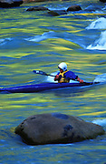 THIS PHOTO IS AVAILABLE FOR WEB DOWNLOAD ONLY. PLEASE CONTACT US FOR A LARGER PHOTO. Idaho. Kayaking in gold, green water. Ken Long, MR