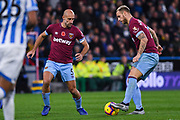Marko Arnautovic of West Ham United (7) passes the ball to Pablo Zabaleta of West Ham United (5) during the Premier League match between Huddersfield Town and West Ham United at the John Smiths Stadium, Huddersfield, England on 10 November 2018.