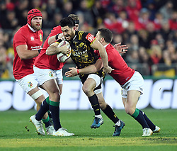 """Nehe Milner-Skudder of the Hurricanes attempts to split the Lions defence in the International rugby match between the the Super Rugby Hurricanes and British and Irish Lions at Westpac Stadium, Wellington, New Zealand, Tuesday, June 27, 2017. Credit:SNPA / Ross Setford  **NO ARCHIVING"""""""
