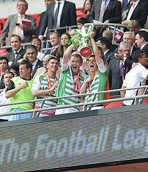 Yeovil Town's Paddy Madden and Yeovil Town's Kevin Dawson  Lift the League one Play off Trophy as he and his Yeovil Team mates celebrate winning the League One Play Off Final  - Photo mandatory by-line: Joe Meredith/JMP - Tel: Mobile: 07966 386802 19/05/2013 - SPORT - FOOTBALL - LEAGUE 1 - PLAY OFF - FINAL - Wembley Stadium - London - Brentford V Yeovil Town