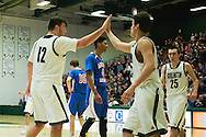 Burlington's Asmin Mostarlic (12) high fives Kevin Garrison (24) during the boys high school semi final basketball game between the Mount Anthony Patriots and the Burlington Sea Horses at Patrick Gym on Saturday afternoon February 27, 2016 in Burlington. (BRIAN JENKINS/for the FREE PRESS)