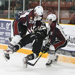 "TRENTON, ON  - MAY 4,  2017: Canadian Junior Hockey League, Central Canadian Jr. ""A"" Championship. The Dudley Hewitt Cup. Game 6 between Trenton Golden Hawks and the Dryden GM Ice Dogs.  Cody Wardner #20 and  Colton Sandboe #19 of the Dryden GM Ice Dogs makes the hit on Jeremy Pullara #21 of the Trenton Golden Hawks during the second period.<br /> (Photo by Tim Bates / OJHL Images)"