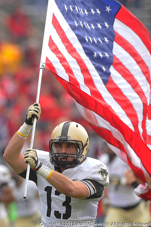 10 November 2012: Army Black Knights running back Jon Crucitti carries the American Flag on the field during NCAA college football action between the Rutgers Scarlet Knights and Army Black Knights at High Point Solutions Stadium in Piscataway, N.J..