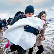 After crossing the Macedonian-Serbian border, refugees walk the unofficial refugee route in subfreezing snowy weather. Near Miratovac, Serbia, January 2016. <br /> <br /> According to UNHCR, 67,415 refugees landed in Greece in January 2016, most of who traveled the route through Serbia on their way to Western Europe. The number of refugees arriving in Greece has dropped significantly since the Balkan border closures in March 2016. With the continuing conflicts in Syria and elsewhere, the refugee crisis is certain to go on as well. Millions of regular people will continue to seek safety and some sense of normalcy in the absence of peace. Produced for Mercy Corps.