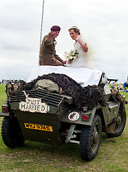 Wedding Armoured Car, The Bride and Groom andy and Kath arrive for picture at the Windmill on Lytham Green in Andys Dingo Scout car after the couple were wed at at Saint John The Divine Church Lytham during the  Lytham 1940's war weekend..19 August 2011  Image © Paul David Drabble