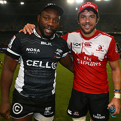 DURBAN, SOUTH AFRICA - APRIL 09: Tendai Mtawarira (captain) of the Cell C Sharks with Warren Whiteley of the Emirates Lions during the 2016 Super Rugby match between Cell C Sharks and Emirates Lions at Growthpoint Kings Park on April 09, 2016 in Durban, South Africa. (Photo by Steve Haag/Gallo Images)