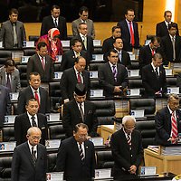 Malaysia's Members of Parliament stand during moment of silence for passengers and crew of the Malaysian Airline crash flight MH17 at Parliament House in Kuala Lumpur, Malaysia 23 July 2014. The Netherlands was expecting the first remains of victims in the flight MH17 disaster to arrive 23 July from Ukraine, where Dutch officials received the plane's flight recorders overnight.