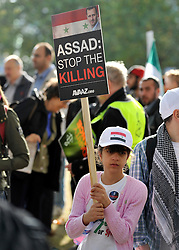 "35559258© Licensed to London News Pictures. 29/10/2011. London, UK.  A young girl carries a banner calling for the killing to be stopped. Amnesty International join Syrians in the UK for a ""N0 More Blood - No More Fear"" march and rally in Paddington Green, London, today 29th October 2011. Activists claim  Syrian security forces opened fire on Friday on protesters and hunted them down in house-to-house raids, killing about 40 people in the deadliest day in weeks in the country's 7-month-old uprising. Photo: Stephen Simpson/LNP"