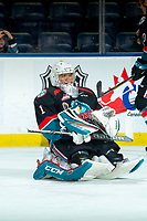 KELOWNA, CANADA - SEPTEMBER 22:  James Porter #1 of the Kelowna Rockets stretches on the ice during warm up against the Kamloops Blazers on September 22, 2018 at Prospera Place in Kelowna, British Columbia, Canada.  (Photo by Marissa Baecker/Shoot the Breeze)  *** Local Caption ***