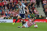 West Bromwich Albion midfielder James Morrison wins a tackle against Stoke City midfielder Xherdan Shaqiri during the Barclays Premier League match between Stoke City and West Bromwich Albion at the Britannia Stadium, Stoke-on-Trent, England on 29 August 2015. Photo by Aaron Lupton.