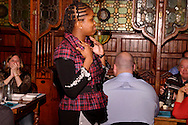"""An audience member 'on the runway' as part of a fashion show during Mayhem & Mystery's production of """"Fashion Friction"""" at the Spaghetti Warehouse in downtown Dayton, Monday, March 21, 2011."""