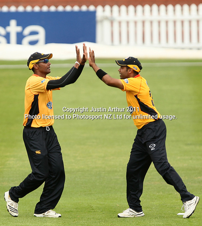 Barry Rhodes and Jeetan Patel celebrate another wicket. $Ford Trophy - Wellington Firebirds v Otago Volts, Hawkins Basin Reserve, Sunday 4 December 2011. Photo: Justin Arthur / Photosport.co.nz