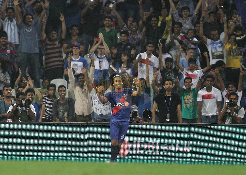 Singam Subash Singh of Mumbai City FC celebrates after scoring a goal during match 6 of the Hero Indian Super League between Mumbai City FC and FC Pune City held at the D.Y. Patil Stadium, Navi Mumbai, India on the 18th October 2014.<br /> <br /> Photo by:  Vipin Pawar/ ISL/ SPORTZPICS