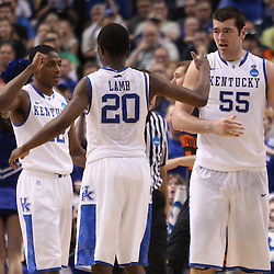 Mar 17, 2011; Tampa, FL, USA; Kentucky Wildcats players Brandon Knight (12), Doron Lamb (20) and Josh Harrellson (55) during second half of the second round of the 2011 NCAA men's basketball tournament against the Princeton Tigers at the St. Pete Times Forum. Kentucky defeated Princeton 59-57.  Mandatory Credit: Derick E. Hingle