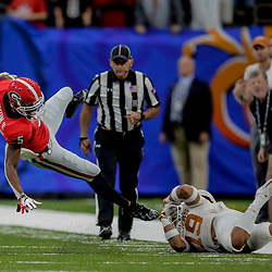 Jan 1, 2019; New Orleans, LA, USA; Georgia Bulldogs wide receiver Terry Godwin (5) is tackled by Texas Longhorns defensive back Brandon Jones (19) during the first quarter in the 2019 Sugar Bowl at Mercedes-Benz Superdome. Mandatory Credit: Derick E. Hingle-USA TODAY Sports