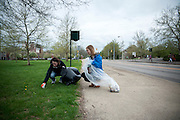 Kate Hiller and Caroline Bertles remove trash from the side of Richland Avenue near Peden Stadium on Sunday, April 19 for Athens Beutification Day. The event is put on by Ohio University's Community Leadership Council and involves students and members of the community volunteering to clean up Athens.