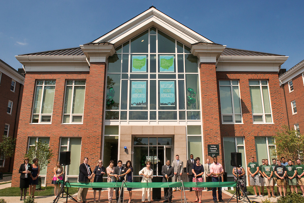 President McDavis, Vice President of Student Affairs Jenny Hall-Jones, and othered honored guests prepare to cut the ribbon during the Ohio University Residential Housing Phase 1 opening ceremony event on Saturday, August 29, 2015 at the Living Learning Center on the Ohio University campus in Athens, Ohio.