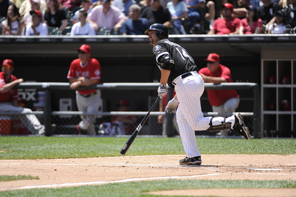 CHICAGO - JULY 08:  Paul Konerko #14 hits a sacrifice fly to drive in Juan Pierre #1 of the Chicago White Sox with the only run of the game in the first inning against the Los Angeles Angels of Anaheim on July 8, 2010 at U.S. Cellular Field in Chicago, Illinois.  The White Sox defeated the Angels 1-0.  (Photo by Ron Vesely)