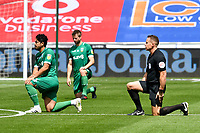 Football - 2019 / 2020 Championship - Swansea City vs Sheffield Wednesday<br /> <br /> referee Mr S. Martin takes the knee<br /> in a match played with no crowd due to Covid 19 coronavirus emergency regulations, at the almost empty Liberty Stadium.<br /> <br /> COLORSPORT/WINSTON BYNORTH