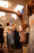 Eileen Brazil, center, and her mother Sheila dance during the Pediatrics Prom at Memorial Sloan-Kettering Cancer Center in Manhattan, NY. 6/7/2005 Photo by Jennifer S. Altman