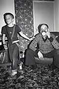 Neville, Richard drinking tea in Front Room, Hawthorne Road, High Wycombe, UK. 1980s.