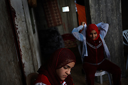 Huda Ghalia, 12, is seen with with her sister Omuma, 13, inside their home in Gaza, Palestinian Territories, Nov. 17, 2006. Ghalia gained attention after members of her family were killed in an explosion that Palestinians say was caused by Israeli artillery fire, a charge Israel denies. According to Human Rights Watch, since September 2005, Israel has fired about 15,000 rounds at Gaza while Palestinian militants have fired around 1,700 back.