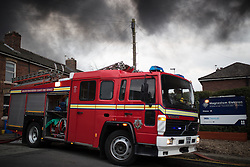 "© Licensed to London News Pictures . 15/03/2015 . Salford , UK . Fire engine at the scene . Roads are closed and people have been evacuated as a large fire burns at a unit within "" Junction Eco-Park "" in Clifton , Greater Manchester , this evening (Sunday 15th March 2015) . The smoke and flames can be seen for many miles . Forty fire fighters are at the scene working to control the blaze . Photo credit : Joel Goodman/LNP"