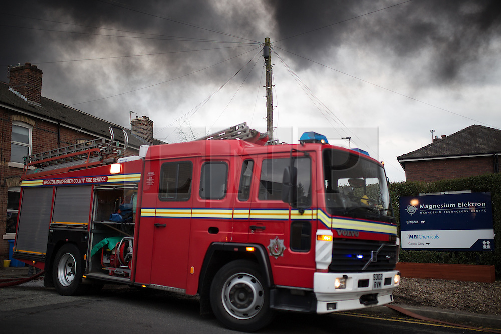 """© Licensed to London News Pictures . 15/03/2015 . Salford , UK . Fire engine at the scene . Roads are closed and people have been evacuated as a large fire burns at a unit within """" Junction Eco-Park """" in Clifton , Greater Manchester , this evening (Sunday 15th March 2015) . The smoke and flames can be seen for many miles . Forty fire fighters are at the scene working to control the blaze . Photo credit : Joel Goodman/LNP"""